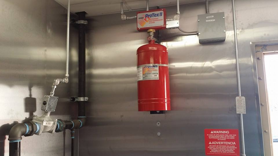 Range hood fire suppression system